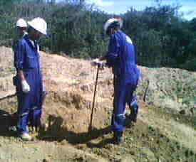 workers drilling into earth